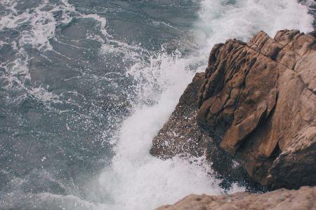 Breaking waves on a rock