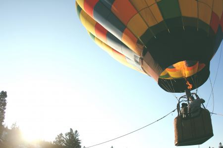 Hot air balloon flying with people