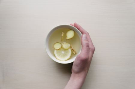 Cup of tea with lemon pieces