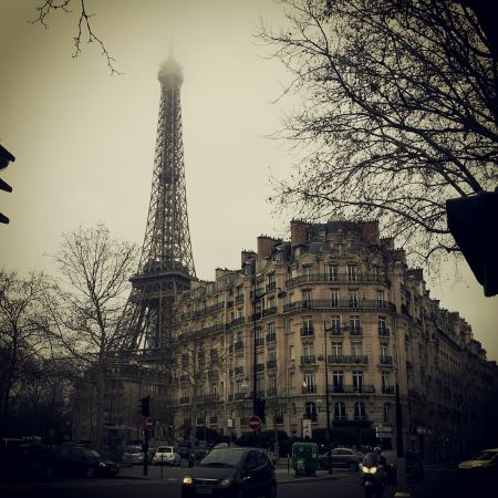 Eiffel Tower and a building in Paris