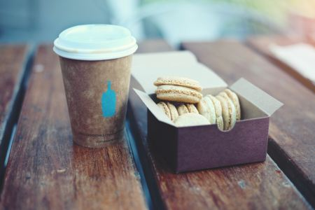 Cookies and coffee on wood table