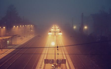 Lighted train station on a foggy night