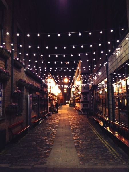 Lights above an alley with benches
