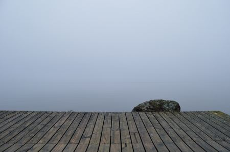 Foggy lake seen from the pier