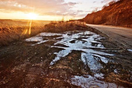 Muddy water in sunlight